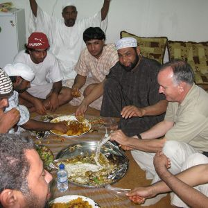 "Enjoying a traditional Arab ""Mansef"" of ""hammour"", a delicious fish caught in the Arab Gulf. [photo by Charles Goslin}"