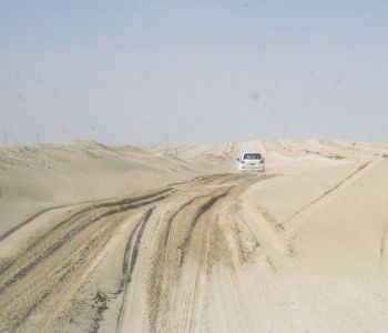 Navigating thick sand in UAE's Eastern Desert while on a pipeline survey